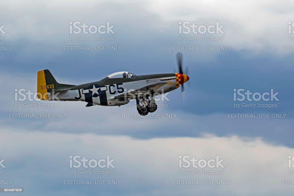 Airplane P-51 Mustang take-off during air show stock photo