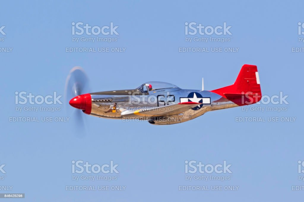 Airplane P-51 Mustang WWII aircraft flying at the airshow stock photo