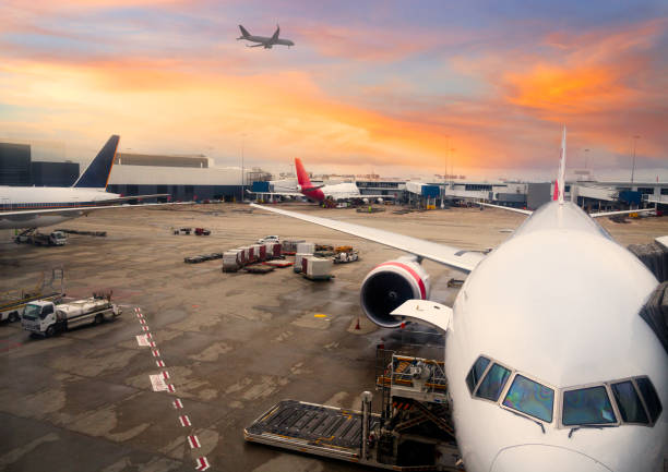 Airplane parked at Sydney International Airport stock photo
