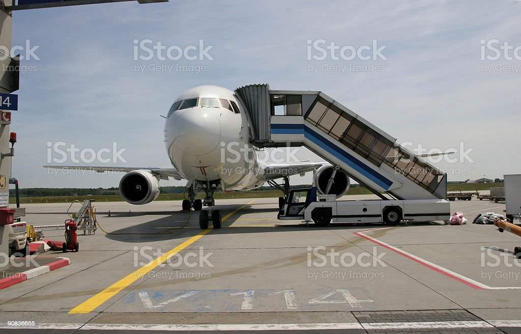 Airplane parked royalty-free stock photo