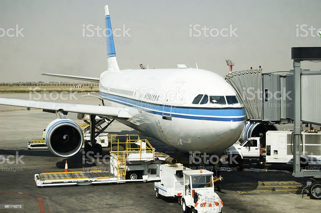 Airplane parking at gate royalty-free stock photo
