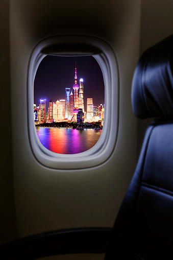 Airplane Passenger Empty Seat And Window View To Pudong District