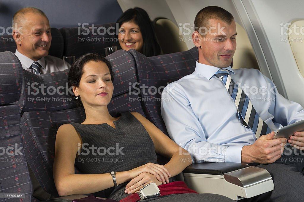 Airplane passenger relax during flight cabin sleep stock photo