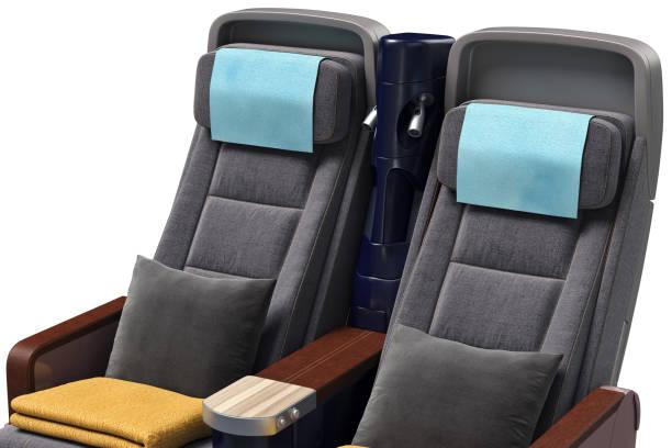 airplane passenger seats, close view - kopfstütze stock-fotos und bilder
