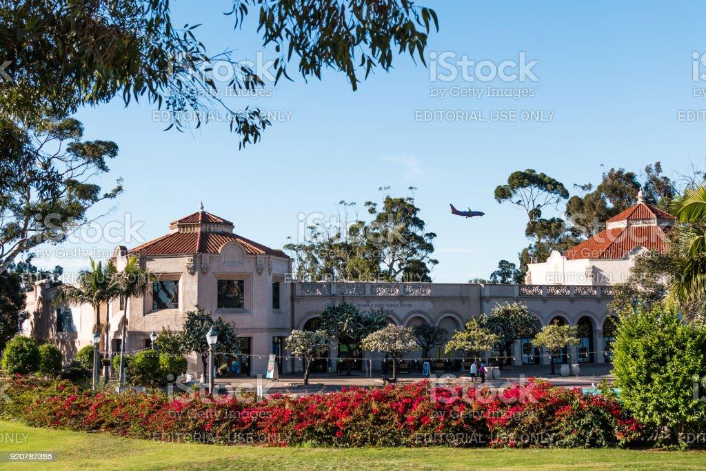 Airplane Passes Over Fleet Science Center stock photo