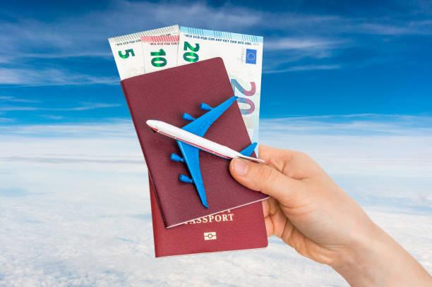 Airplane passport and money in female hand travelling concept picture id933380570?b=1&k=6&m=933380570&s=612x612&w=0&h=payj6fslq 8hajttmrnil8mdwv2fsws8shxixoy9iii=
