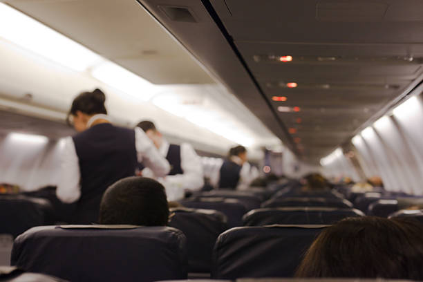 Airplane In the airplane cabin crew stock pictures, royalty-free photos & images