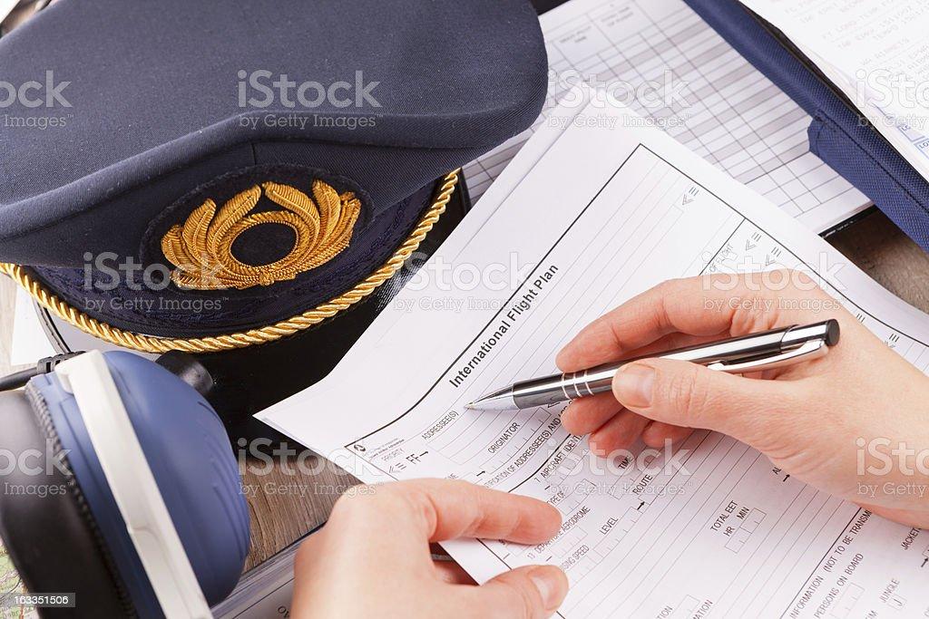 Airplane pilot filling in flight plan royalty-free stock photo
