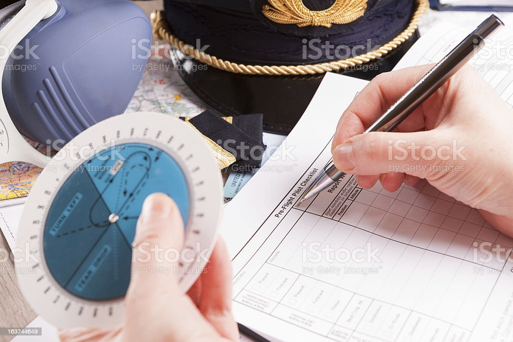 Airplane pilot filling in flight plan royalty-free stock photo
