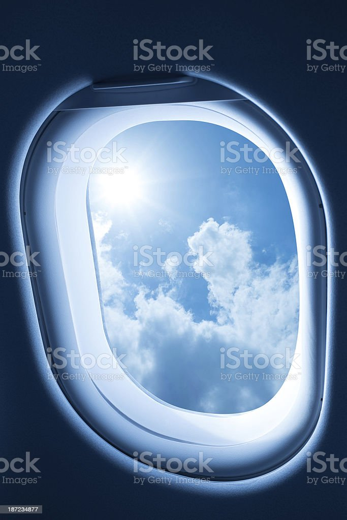 Airplane porthole window (clipping path!) royalty-free stock photo