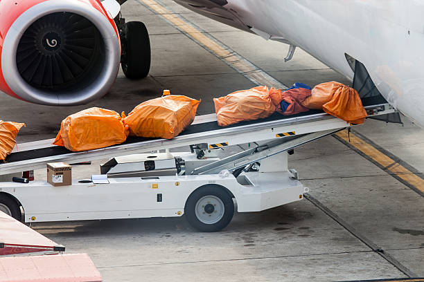 Airplane prepare for fight and loading the bags stock photo