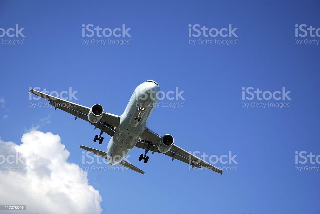 Airplane preparing for landing royalty-free stock photo