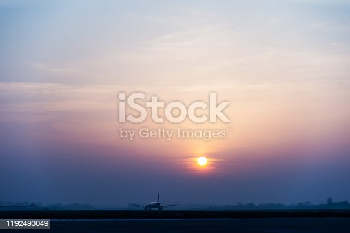 Airplane ready to take off at the sunrise