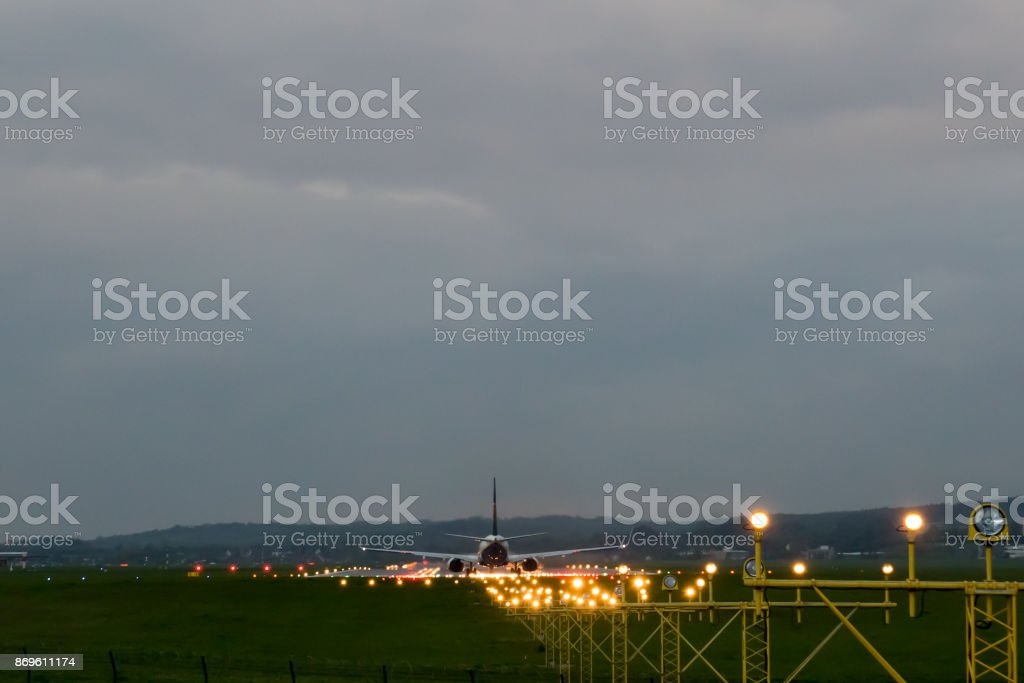Airplane rides on the runway stock photo