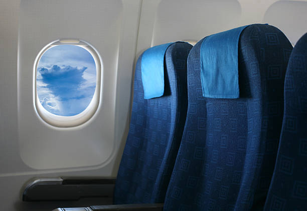 airplane seat and window stock photo