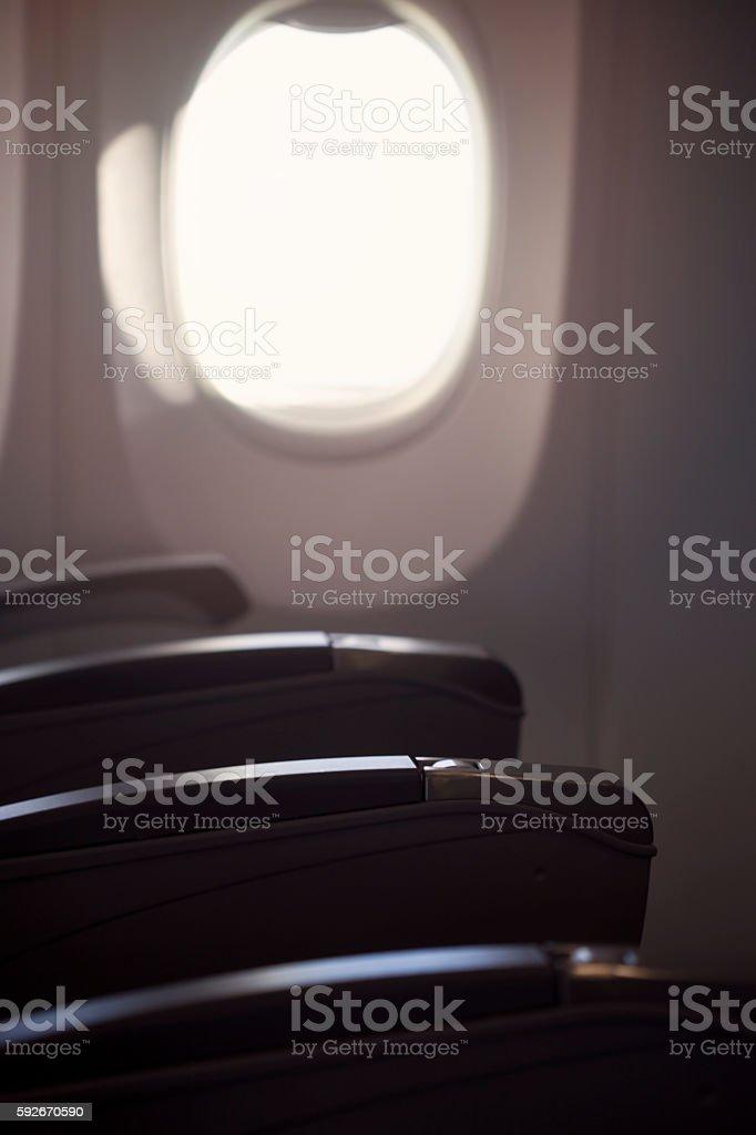 airplane seat and window stock photo