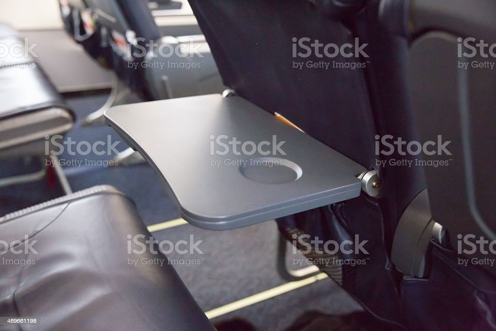 Airplane seat food tray table stock photo