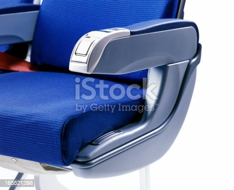 blue airplane seat on white background, selective focus on the foreground, shallow depth of field
