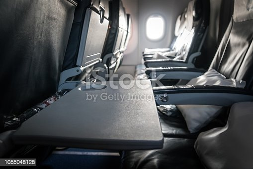 istock Airplane Seat Tray Open Empty Food Waiting 1055048128