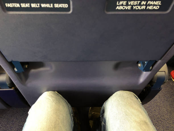 Airplane seat tray warning sign stock photo