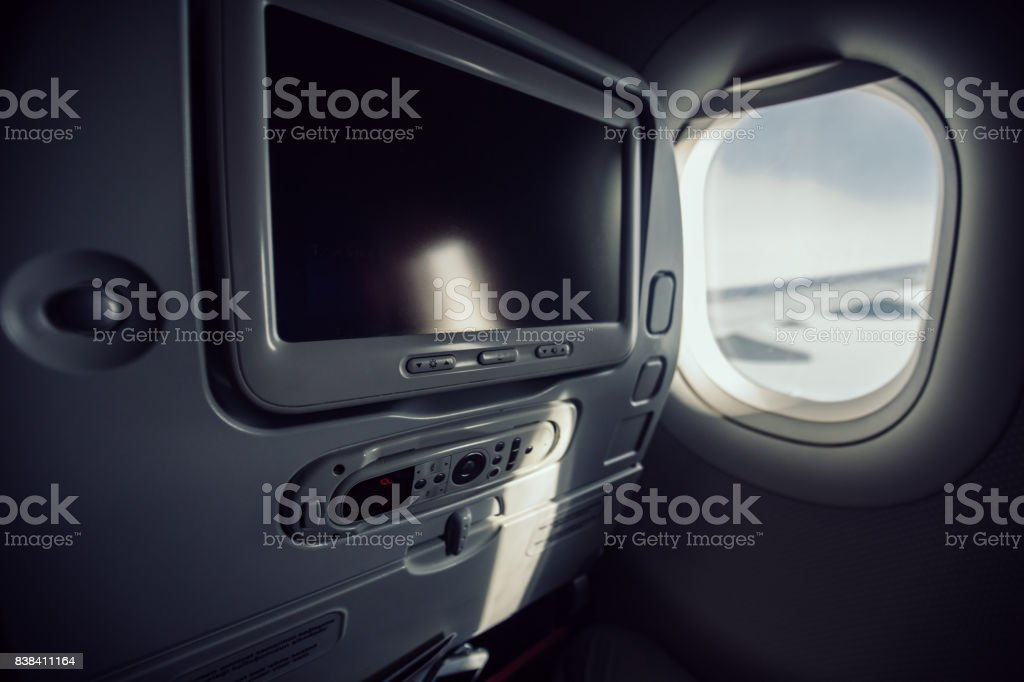 Airplane seat with LCD screen stock photo
