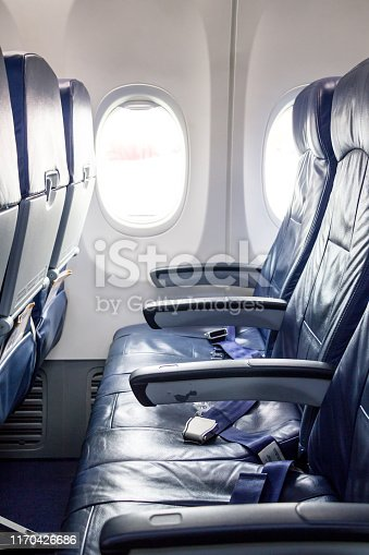 istock airplane seat with seat belt 1170426686