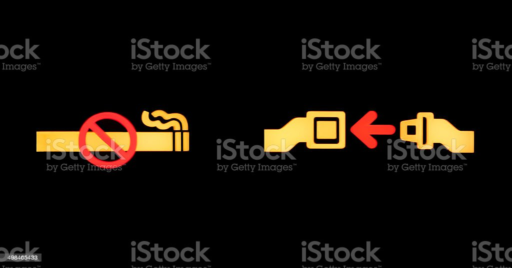 airplane seatbelt and non smoking sign stock photo