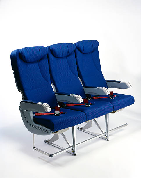 airplane seats three blue airplane seats on white background airplane seat stock pictures, royalty-free photos & images