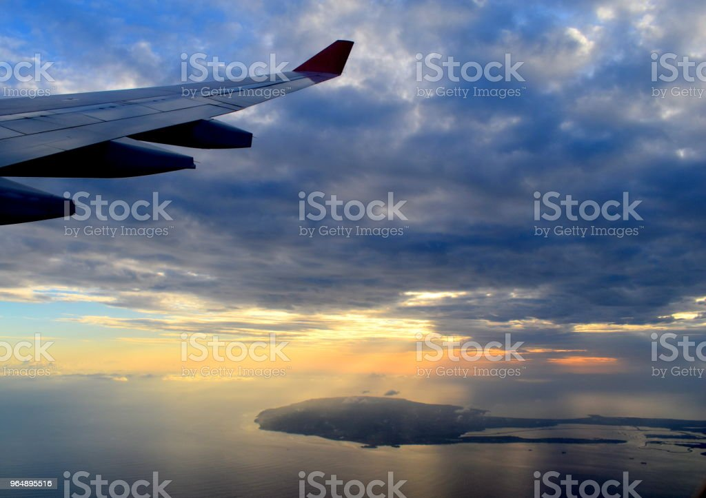 airplane see cloud and sunset royalty-free stock photo