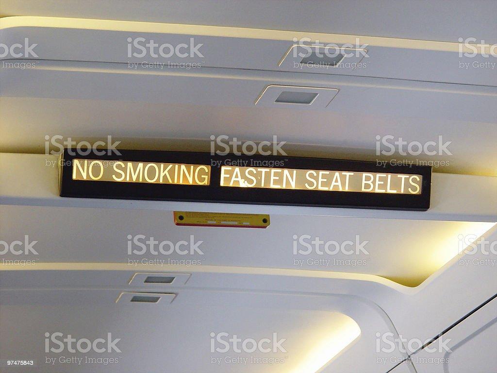 Airplane Sign - No Smoking/Fasten Seat Belts stock photo