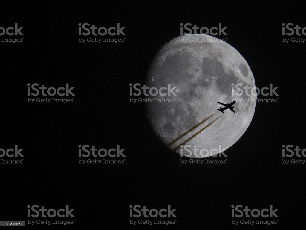 Airplane silhouette on the Moon stock photo
