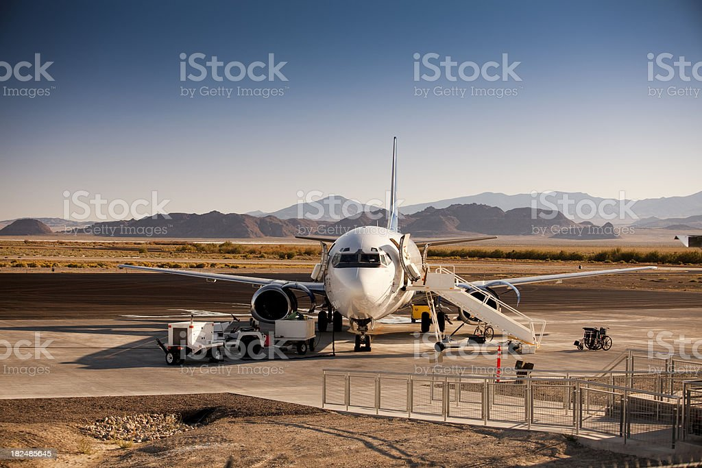 Airplane sits on the private runway royalty-free stock photo