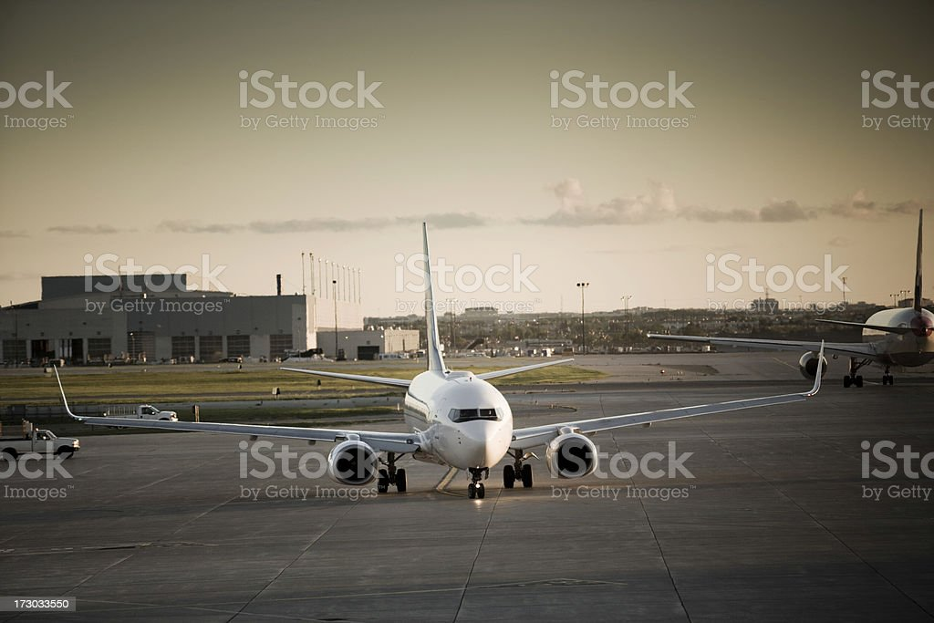 Airplane sits on the runway royalty-free stock photo