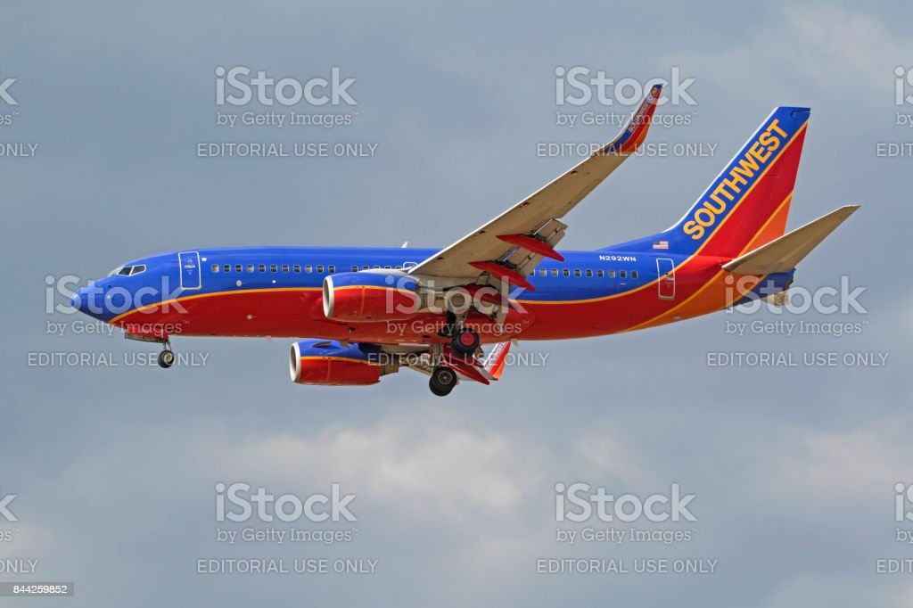 Airplane Southwest Airline 737 jet landinga t Ontario International Airport during summer storm stock photo