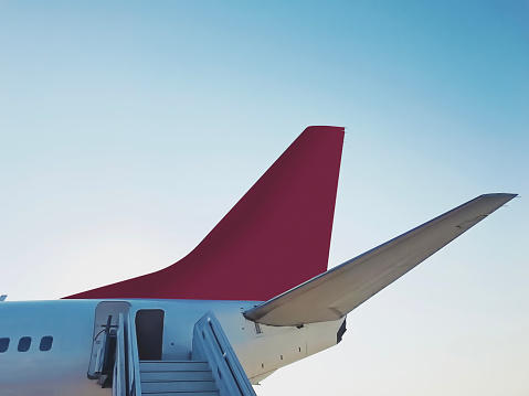 Tail section of a landed commercial airplane
