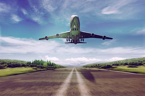 istock airplane take off - landing 606679062
