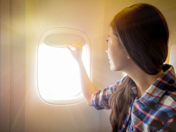 airplane takeoff and landing the window must open stock photo