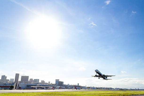 Airplane takeoff at Rio de Janeiro Airplane takeoff at Rio de Janeiro airport Santos Dumont on a clear sunny day. airfield stock pictures, royalty-free photos & images