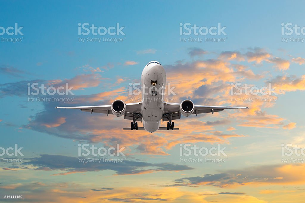 Airplane takeoff in sunrise stock photo