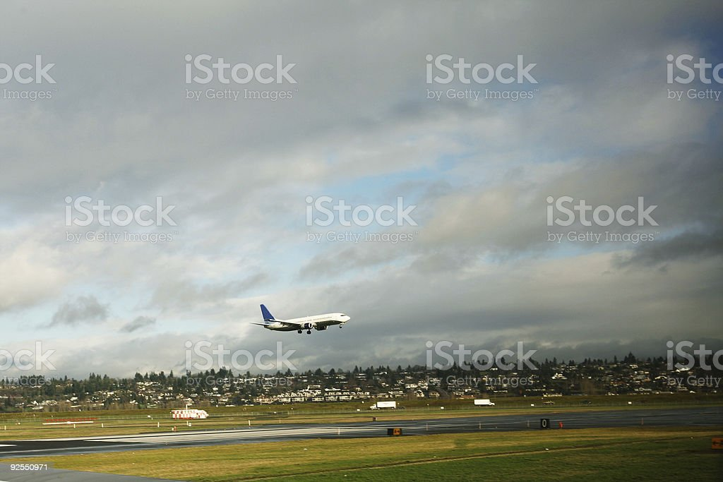 Airplane Taking Off a Runway royalty-free stock photo