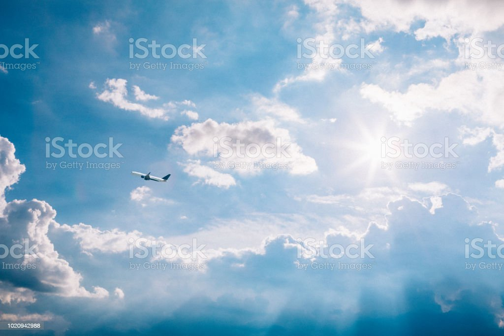 airplane taking off among the clouds stock photo