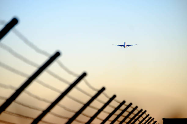 Airplane taking off and flying into the distan stock photo