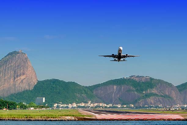 Airplane taking off in Rio de Janeiro stock photo