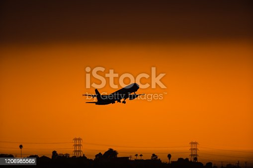 155439315 istock photo LAX airplane taking off on the sunset 1206985565