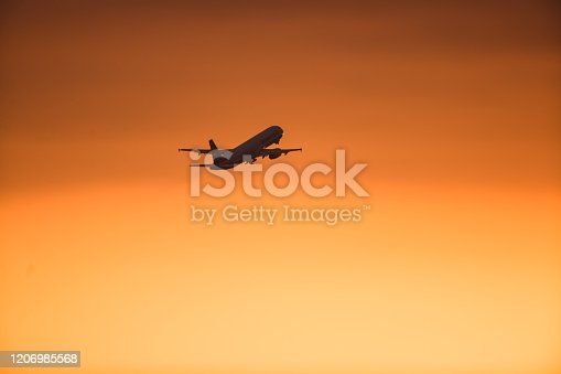 155439315 istock photo LAX airplane taking off on the sunset 1206985568