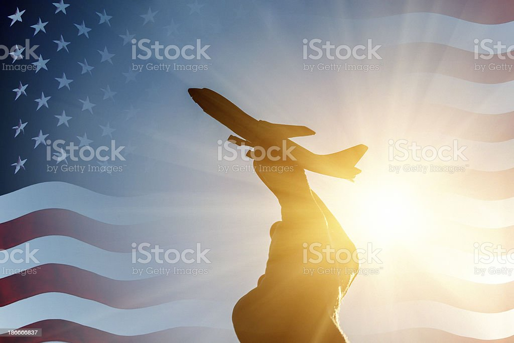 Airplane taking off on USA flag background royalty-free stock photo