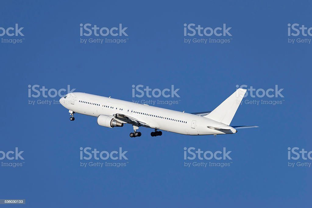 Airplane taking off stock photo
