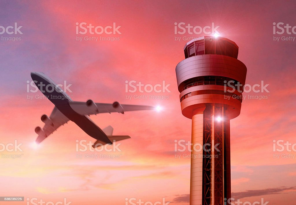 Airplane taking off with control tower at sunset stock photo