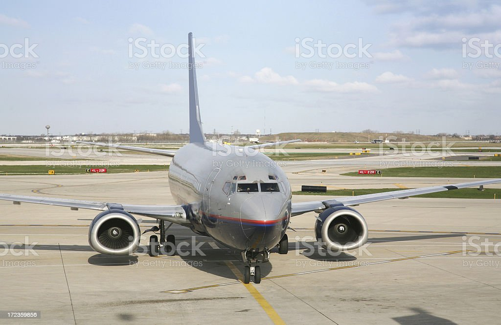Airplane Taxiing To Gate royalty-free stock photo
