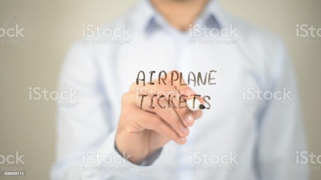 Airplane Ticket, man writing on transparent screen stock photo